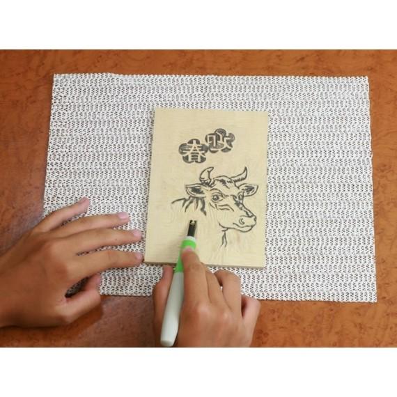 Tapis anti-dérapant pour gravure